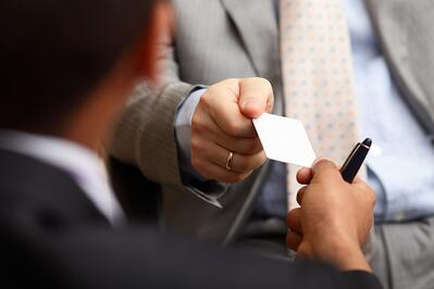 Closeup portrait of two successful business executive exchanging business card.jpeg